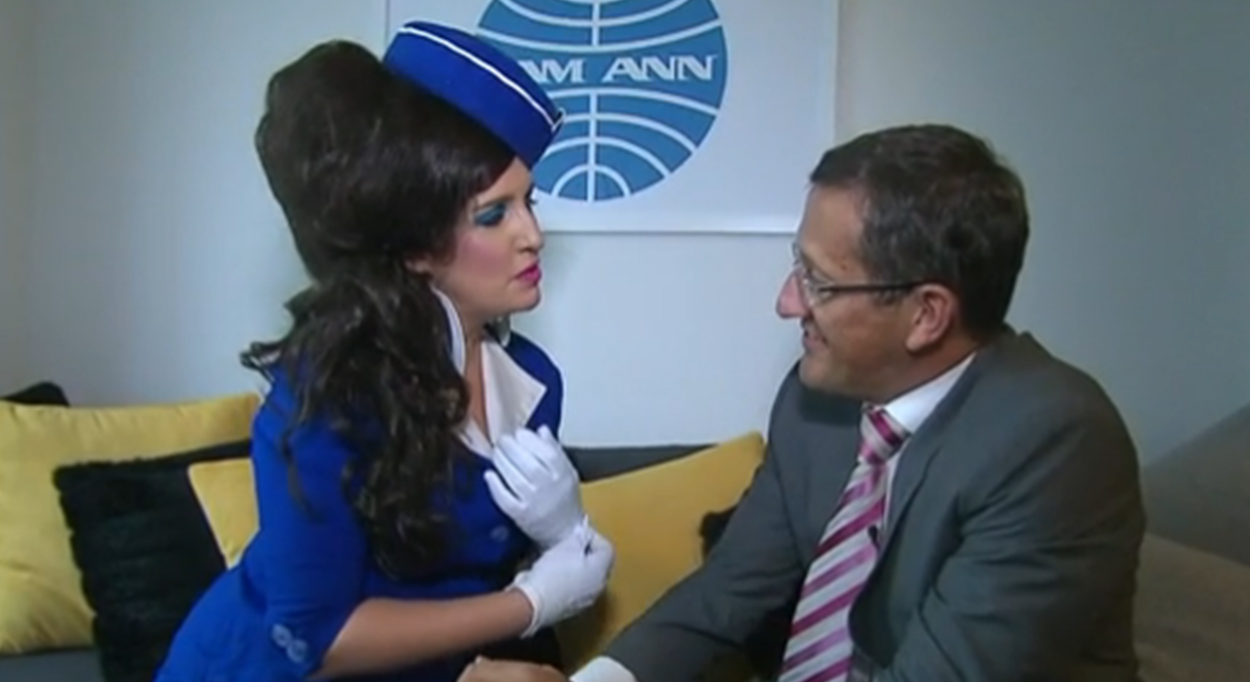 CNN's Richard Quest meets the comedic character Pam Ann whose business is making fun of airlines.